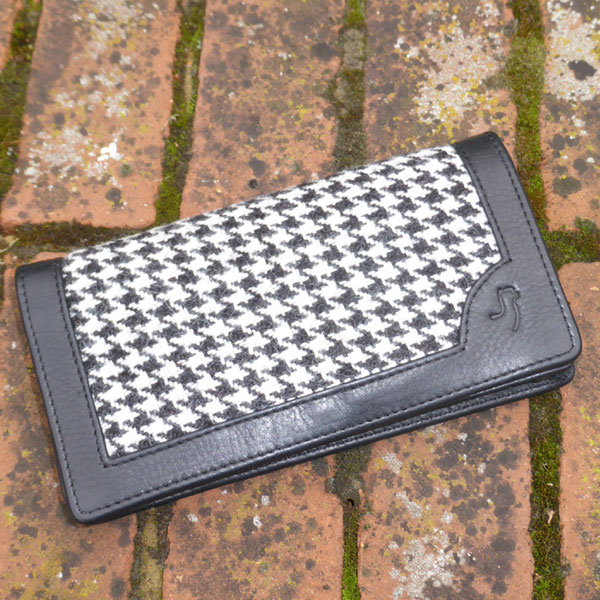 Alpaca purse in black & white dog tooth with black leather.